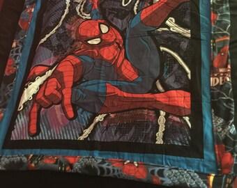 Spiderman swings onto the web