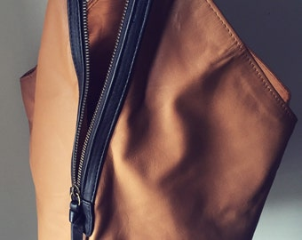 Super soft, leather handbag. Two toned and easy to open this stylish handbag holds everything you need.Customise it to make it your own.