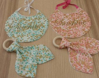 "All bib and teething ring ""Sunshine"", mint green or pale pink."