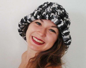 Black and white hand knitted woolen hat