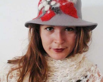 Women grey hat, with a poinsettia flower made of felt