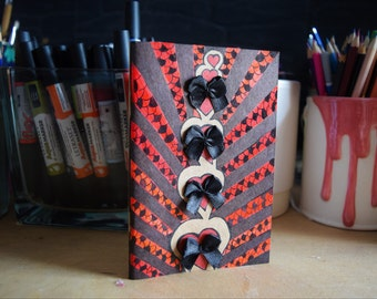 Small notebook with black bows.