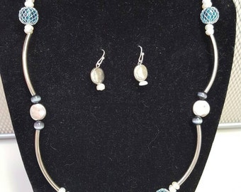Shells, Pearls, Cats eye and Silver