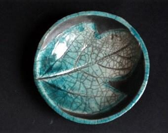 Bowl with a crackle raku ceramic leaf