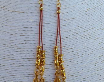 leather brick and gold-plated earrings