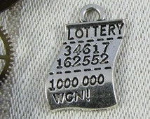 Set of (10) Silver Lottery Ticket Charms, 10 per package. SYM015