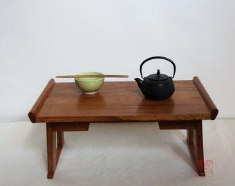 Kiri wood folding table, teak finish.