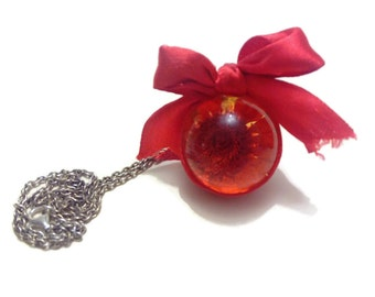 """Pendant """"bubble of nature"""" resin with inclusion real red dried flower and its node Red satin"""