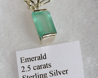 2.5 Carat Emerald Set In A Sterling Silver Pendant With Chain