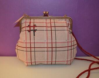 Printed cloth bag and kiss clasp