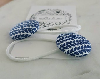 Navy blue and white fabric covered button hair elastics