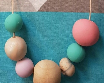 Beautiful children's handmade wooden, silicone and clay bead necklace.