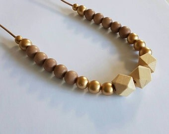 Natural and gold wooden beaded necklace.