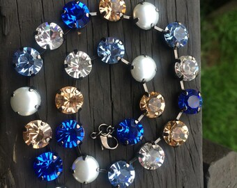 11mm Swarovski crystal necklace featuring blues, gold, pearl