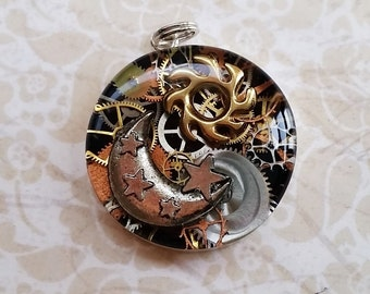 Sterling silver bezel sun moon and stars steampunk resin pendant