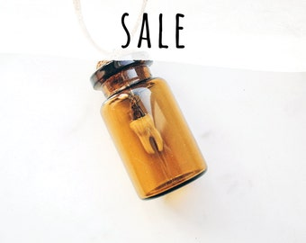 Tooth in a bottle necklace