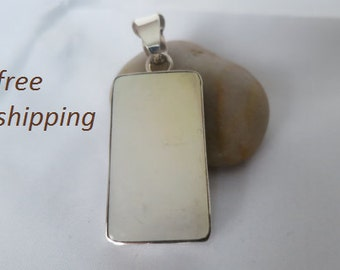 Large mother of pearl pendant set in sterling silver.