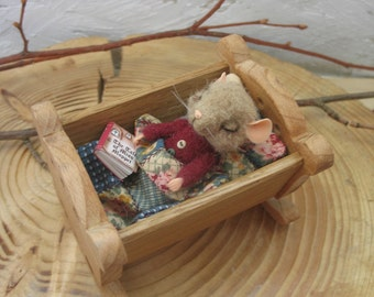 little mouse needle felting in bed with a book of fairy tales of B. Potter