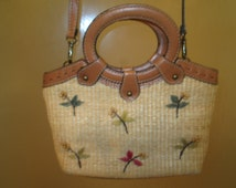 Darling Fossil straw and leather small handbag Detatchable shoulder strap so can be carried as a handbag Small embroidered flowers on front.