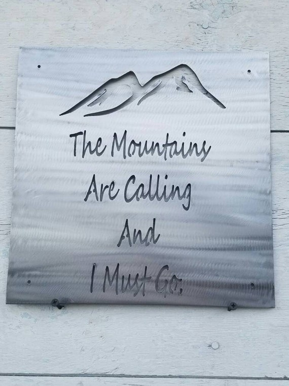 The mountains are calling sign for The mountains are calling and i must go metal sign