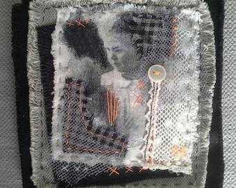 Textile table: Brigitte Bardot child. Hand made jewelry.
