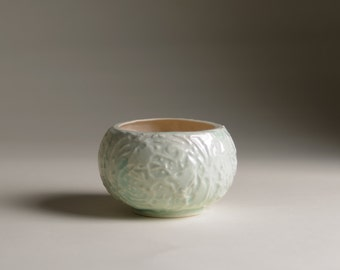 Tealight in slip cast porcelain with green celadon glaze