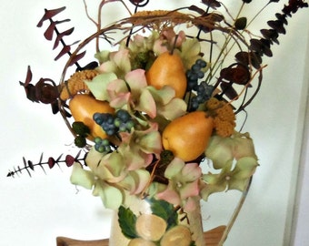 Metal pitcher arrangement with pears and flowers