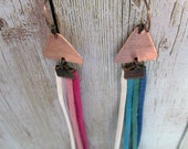 Geometric tassel festival jewellery: mismatched statement long earrings with copper triangles and bright fringes
