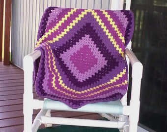 Granny square baby afghan with yellow & purples