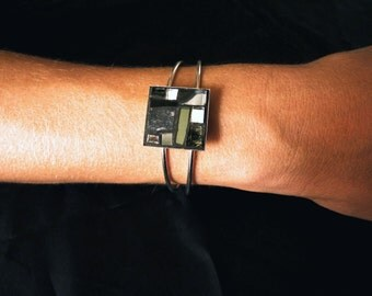 silver tone bracelet with mosaic