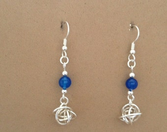 Sterling silver love knot dangle earrings with blue onyx bead.