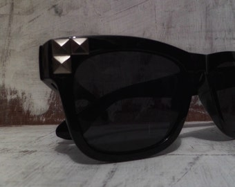 Silver studded black sunglasses