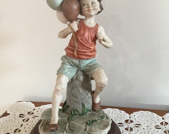 70's Vintage Italian Boy figurine with Balloons, made in Italy.perfect condition.