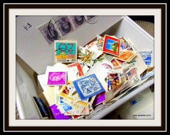 Box filled with hundreds of used postage stamps from over the whole world.