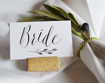 handwritten modern calligraphy place card with laurel branch