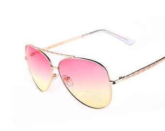 Gold Frame On Pink Under Yellow Sunglasses