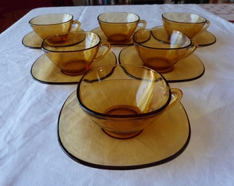 Six stylish, retro amber tempered glass, coffee cups and saucers by Vereco France. French retro glass.