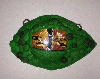 Emerald dragon eye pendant