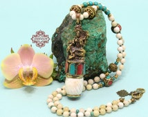 Nepalese Brass Lakshmi Conch Shell Pendant, with Turquoise & Coral Inlay on OOAK Handmade Beaded necklace w/ Mother of Pearl and Turquoise