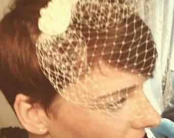 Simple, elegant pearl embellished bow clip birdcage veil