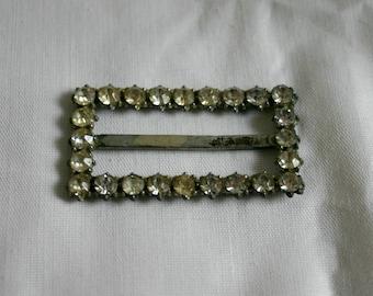 Vintage scarf clip.  With diamond like gems around it.  Very nice.