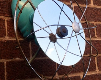 Round Mirror upcycled from a 1940's metal industrial desk / wall fan.