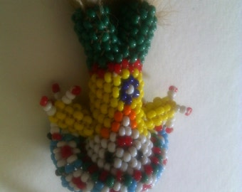 Beaded Chief souvenir doll