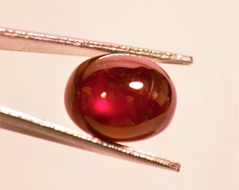 Pigeon Blood Red Star Ruby, Oval Cabochon Cut weighing 7.6 Carats
