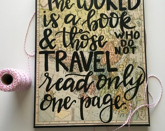 The world is a book and those who do not travel read only one page canvas quote book page art