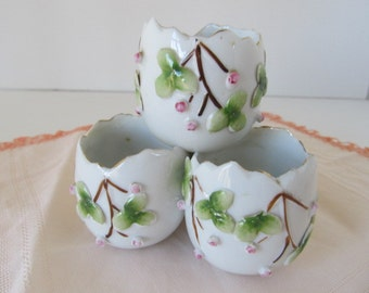 Vintage hand applied ceramic nut cups shaped like eggs and stacked
