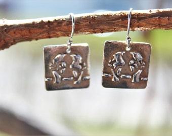Birds-on-a-wire silver earrings