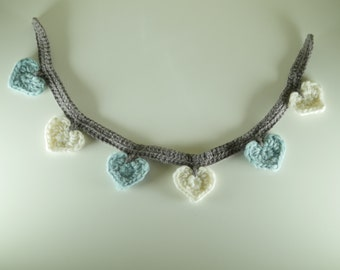 Garland of hearts while wool-