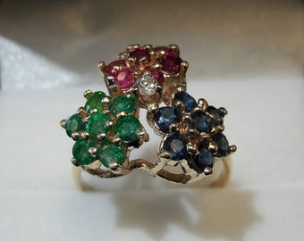 Rubies, sapphires and emerald ring