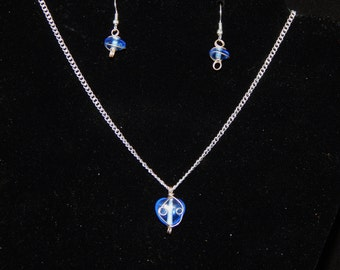Blue wire wrapped necklace and earrings.